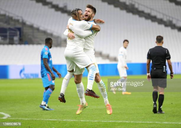 Dimitri Payet of Marseille celebrates his secocnd goal on a penalty kick with Duje Caleta-Car and teammates during the UEFA Champions League Group C...