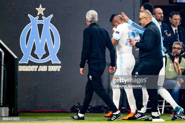 Dimitri Payet of Marseille leaves the pitch after injury during the Europa League Final match between Marseille and Atletico Madrid at Groupama...