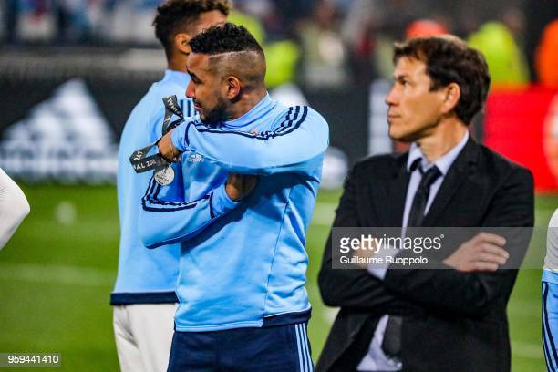 Dimitri Payet of Marseille looks dejected and Rudi Garcia coach of Marseille after the Europa League Final match between Marseille and Atletico...