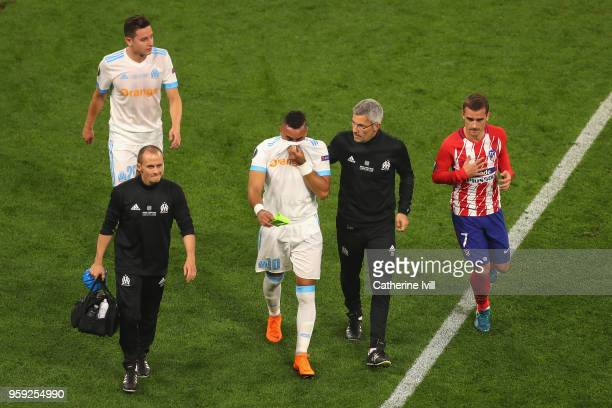 Dimitri Payet of Marseille looks dejected as he walks off the pitch after picking up an injury during the UEFA Europa League Final between Olympique...
