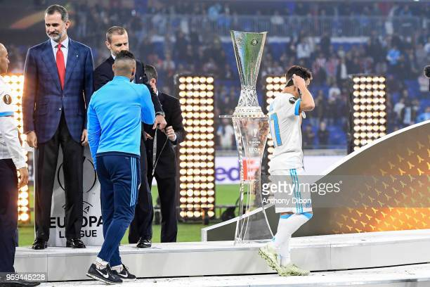 Dimitri Payet of Marseille shakes hand with Aleksander Ceferin under the eyes of Felipe VI king of Spain during the Europa League Final match between...
