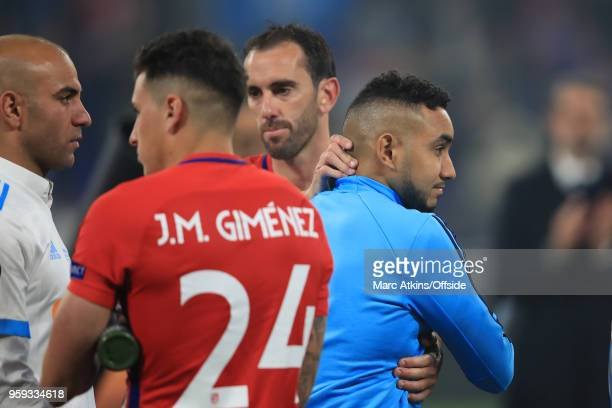 Dimitri Payet of Olympique de Marseille is consoled by Diego Godin of Atletico Madrid during the UEFA Europa League Final between Olympique de...