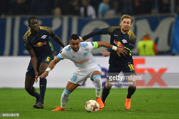Dimitri Payet of Olympique Marseille is tackled by Emil Forsberg of RB Leipzig during the UEFA Europa League quarter final leg two match between...