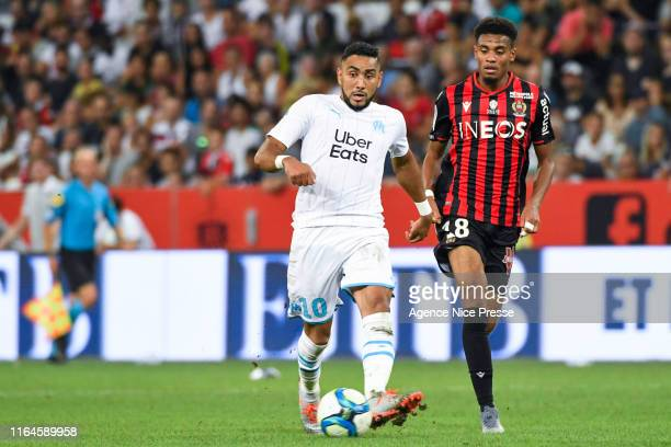 Dimitri Payet of OM and Ihsan Sacko of Nice during the Ligue 1 match between OGC Nice and Olympique de Marseille on August 28, 2019 in Nice, France.