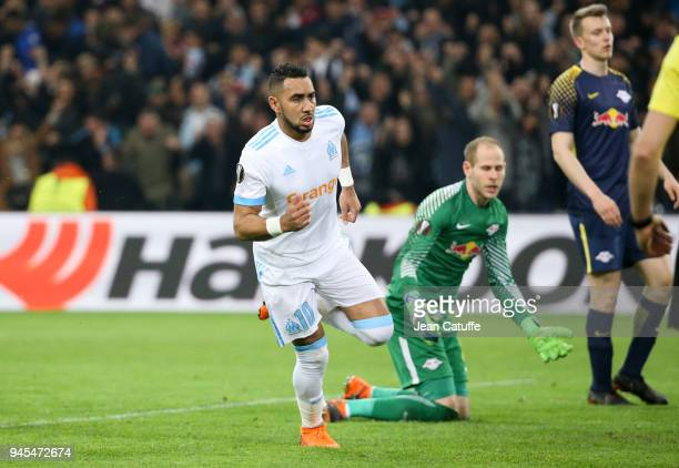 Dimitri Payet of OM celebrates scoring the fourth goal for Marseille while goalkeeper of RB Leipzig Peter Gulacsi reacts during the UEFA Europa...