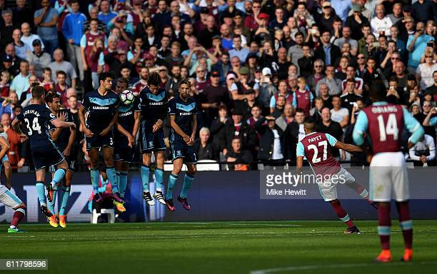 Dimitri Payet of West Ham hits a free kick during the Premier League match between West Ham United and Middlesbrough at London Stadium on October 1...