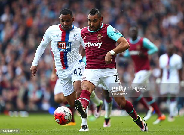 Dimitri Payet of West Ham United and Jason Puncheon of Crystal Palace compete for the ball during the Barclays Premier League match between West Ham...