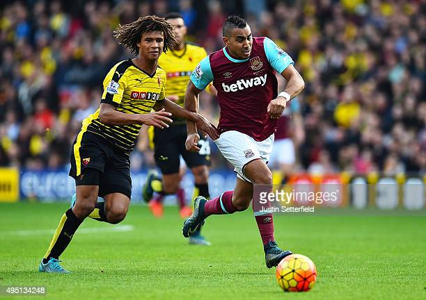 Dimitri Payet of West Ham United and Nathan Ake of Watford compete for the ball during the Barclays Premier League match between Watford and West Ham...