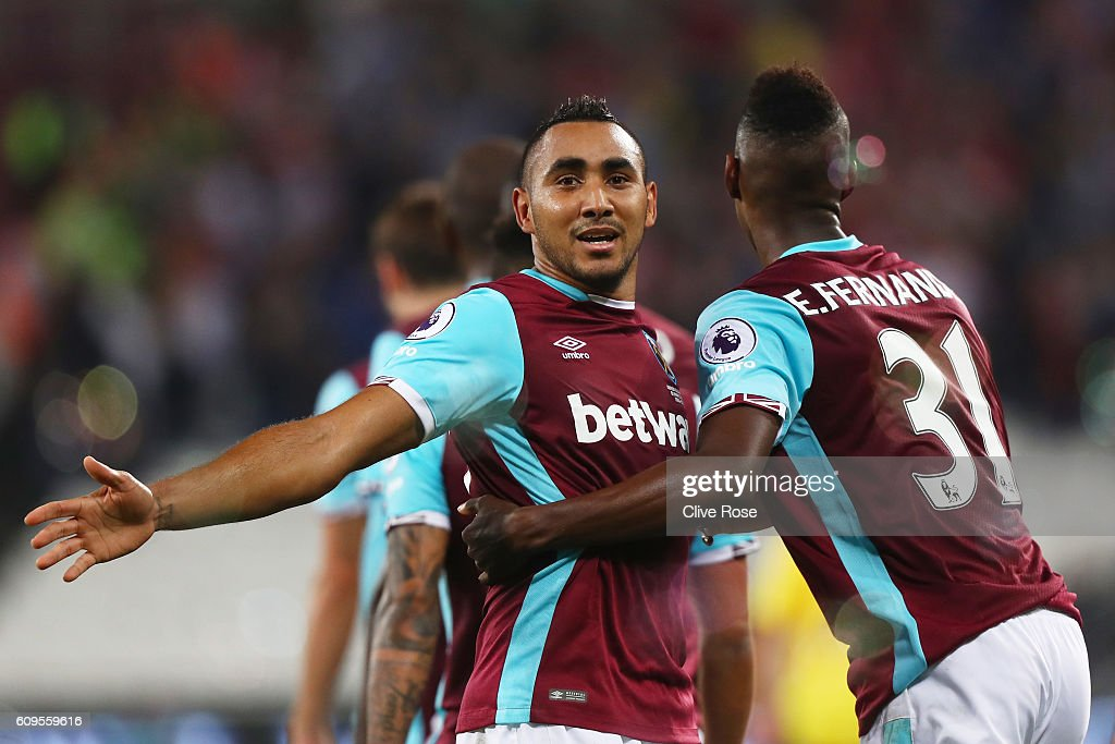 Dimitri Payet of West Ham United celebrates scoring his sides first goal with Edmilson Fernandes of West Ham United during the EFL Cup Third Round match between West Ham United and Accrington Stanley at the London Stadium on September 21, 2016 in London, England.