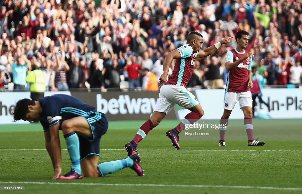 Dimitri Payet of West Ham United celebrates scoring his sides first goal during the Premier League match between West Ham United and Middlesbrough at London Stadium on October 1, 2016 in London, England.