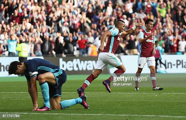 Dimitri Payet of West Ham United celebrates scoring his sides first goal during the Premier League match between West Ham United and Middlesbrough at...