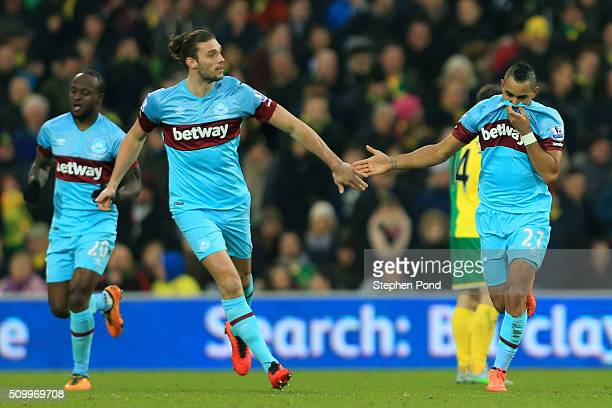 Dimitri Payet of West Ham United celebrates scoring his team's first goal with his team mate Andy Carroll during the Barclays Premier League match...