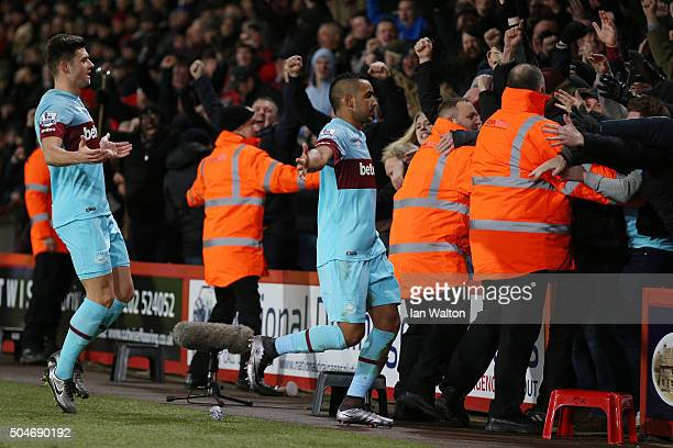 Dimitri Payet of West Ham United celebrates with fans as he scores their first and equalising goal from a free kick during the Barclays Premier...