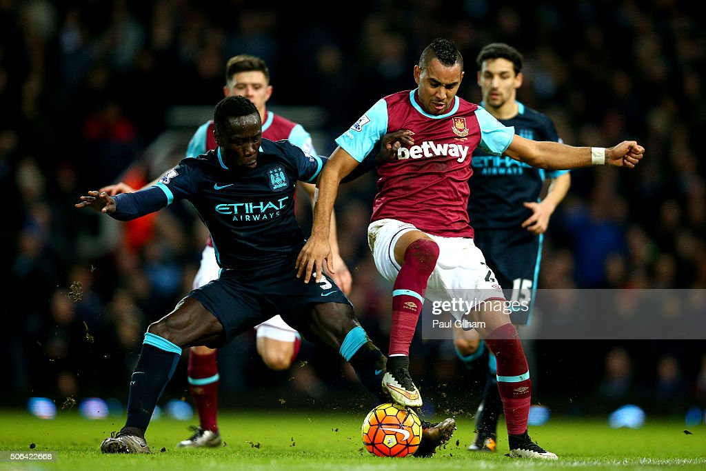 Dimitri Payet of West Ham United is challenged by Bacary Sagna of Manchester City during the Barclays Premier League match between West Ham United and Manchester City at the Boleyn Ground on January 23, 2016 in London, England.