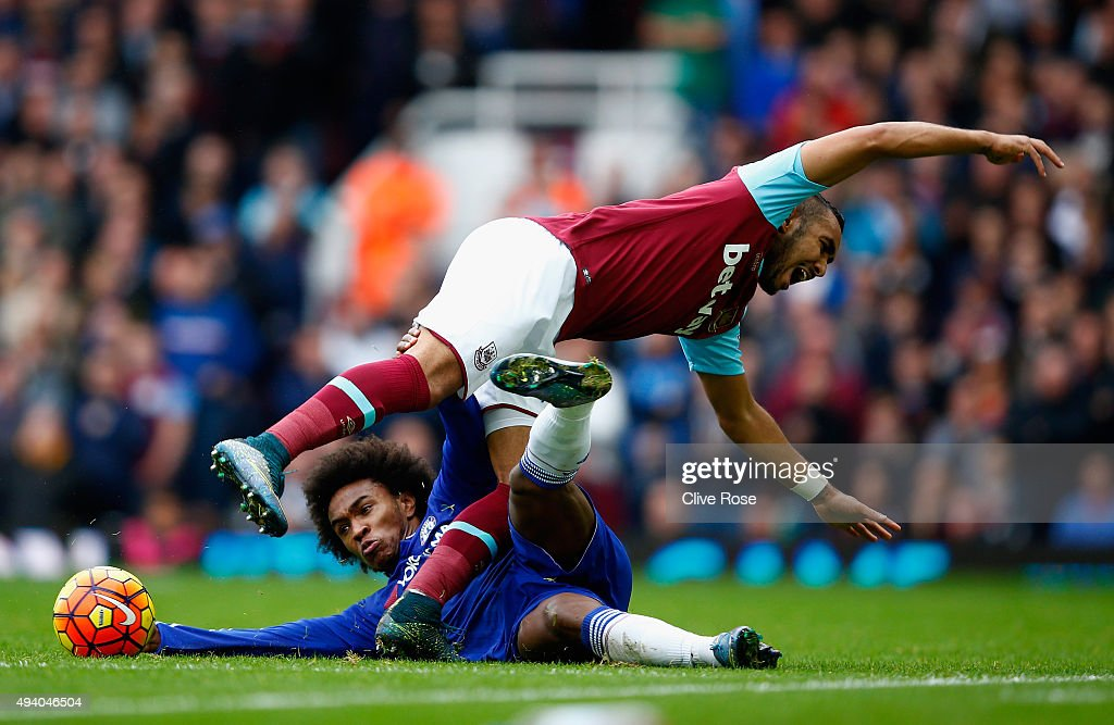 Dimitri Payet of West Ham United is tackled by Willian of Chelsea during the Barclays Premier League match between West Ham United and Chelsea at Boleyn Ground on October 24, 2015 in London, England.