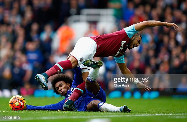 Dimitri Payet of West Ham United is tackled by Willian of Chelsea during the Barclays Premier League match between West Ham United and Chelsea at...