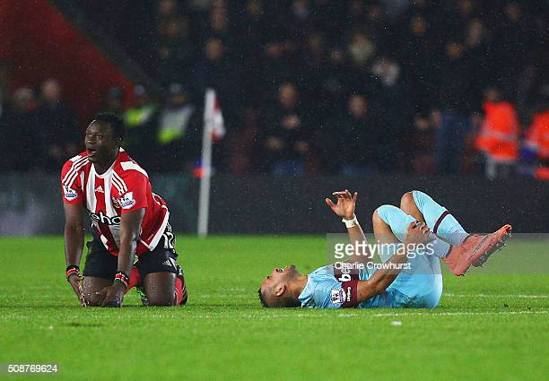Dimitri Payet of West Ham United reacts after a challenge by Victor Wanyama of Southampton who is then sent off during the Barclays Premier League...