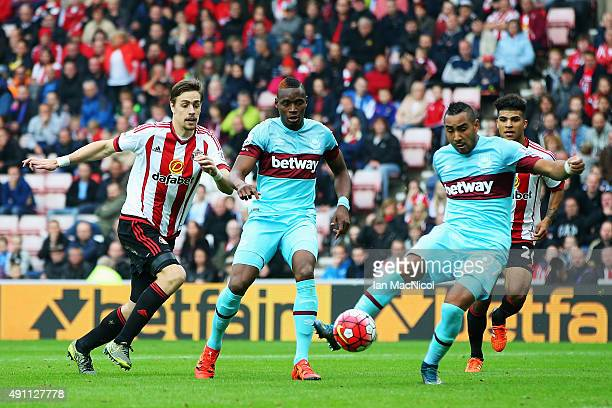 Dimitri Payet of West Ham United scores his team's second goal during the Barclays Premier League match between Sunderland and West Ham United at the...