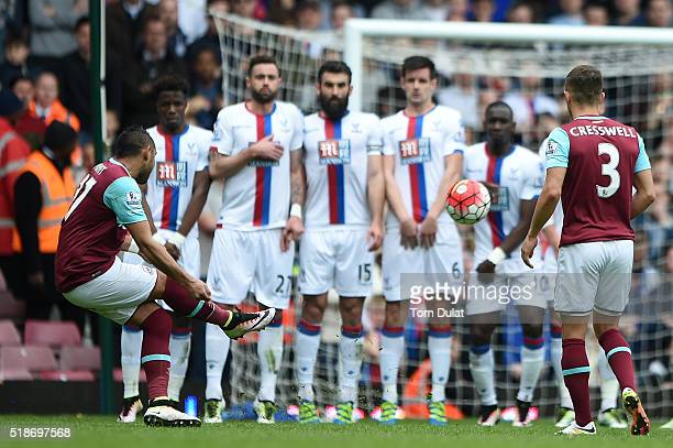 Dimitri Payet of West Ham United scores his team's second goal during the Barclays Premier League match between West Ham United and Crystal Palace at...