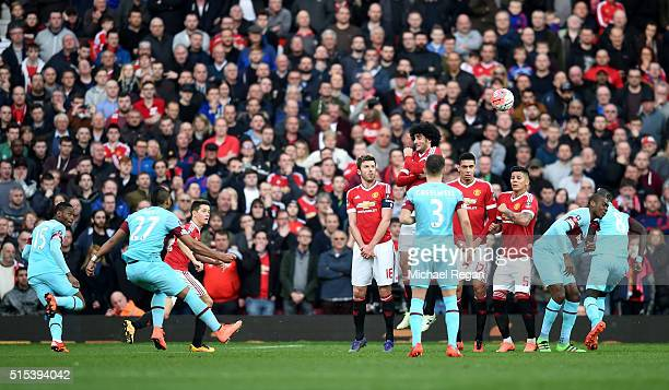Dimitri Payet of West Ham United scores their first goal from a free kick during the Emirates FA Cup sixth round match between Manchester United and...