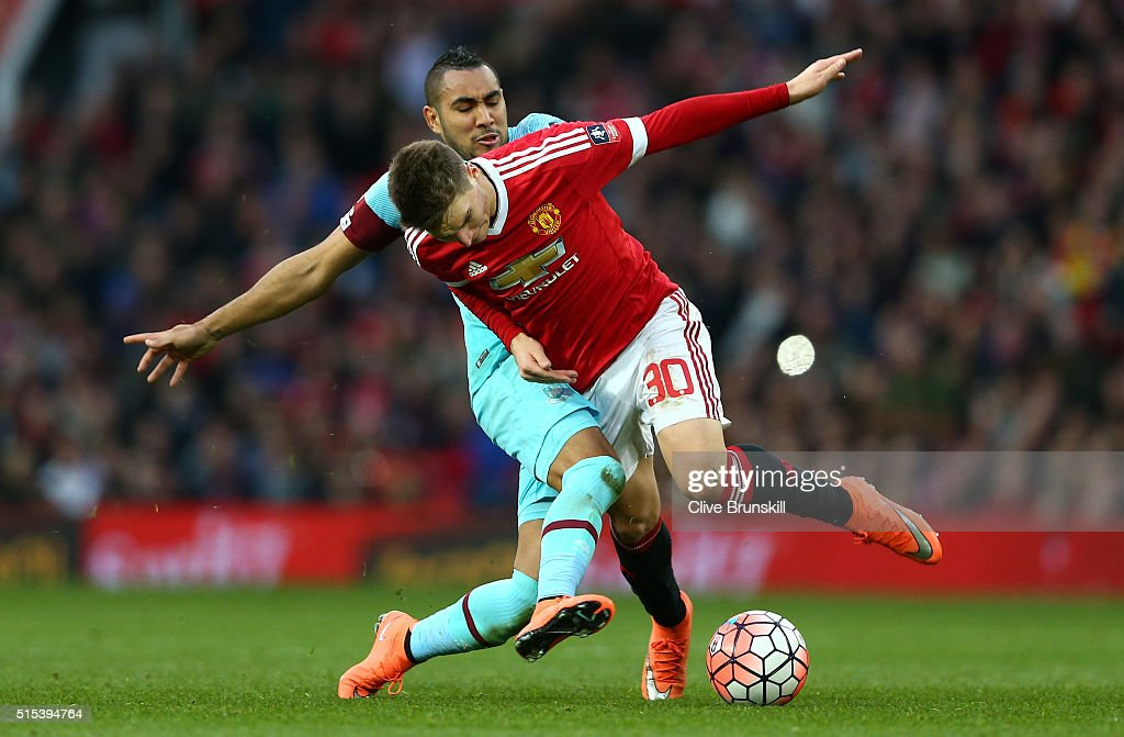 Dimitri Payet of West Ham United tussles with Guillermo Varela of Manchester United during the Emirates FA Cup sixth round match between Manchester United and West Ham United at Old Trafford on March 13, 2016 in Manchester, England.