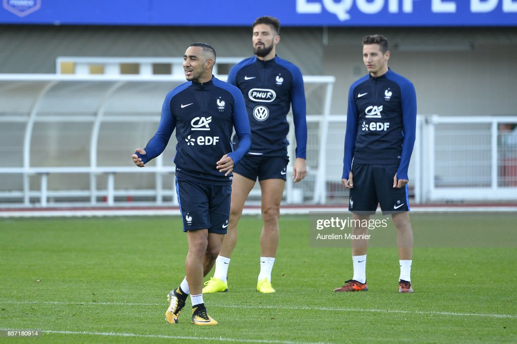 Dimitri Payet, Olivier Giroud and Florian Thauvin of France react during a France training session on October 3, 2017 in Clairefontaine, France.