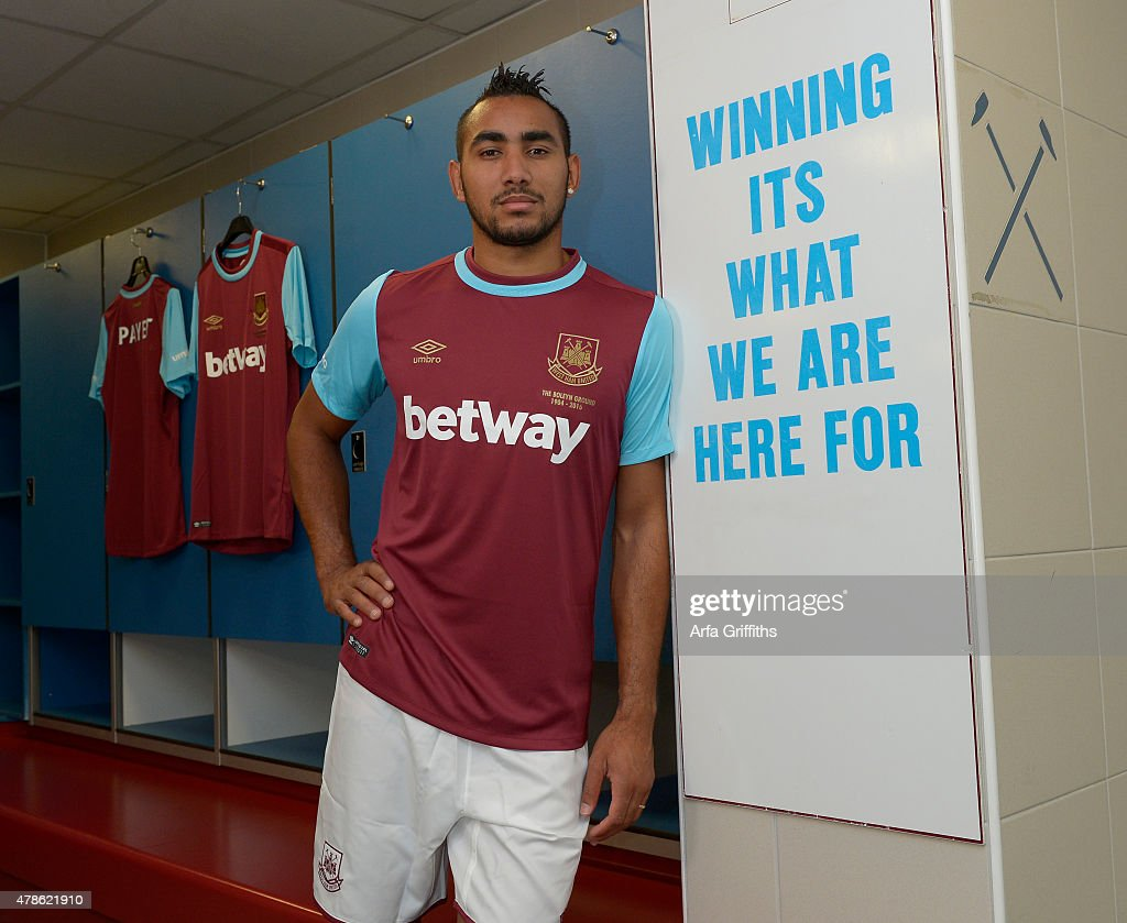 Dimitri Payet poses after signing for West Ham United at Upton Park on June 26, 2015 in London, England.