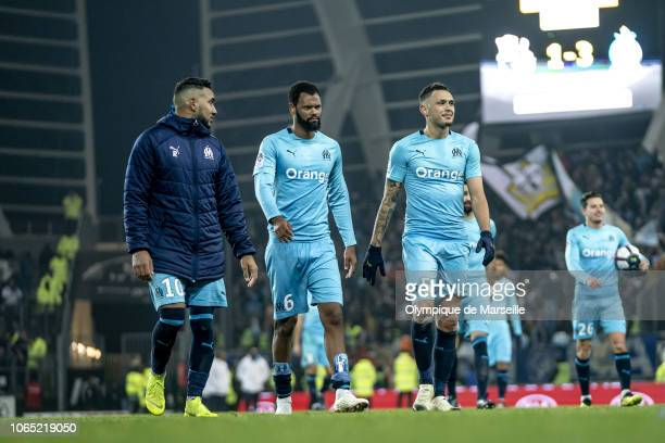 Dimitri Payet Rolando and Lucas Ocampos of Olympique de Marseille react after the 31 victory over Amiens SC after the Ligue 1 match between Amiens SC...
