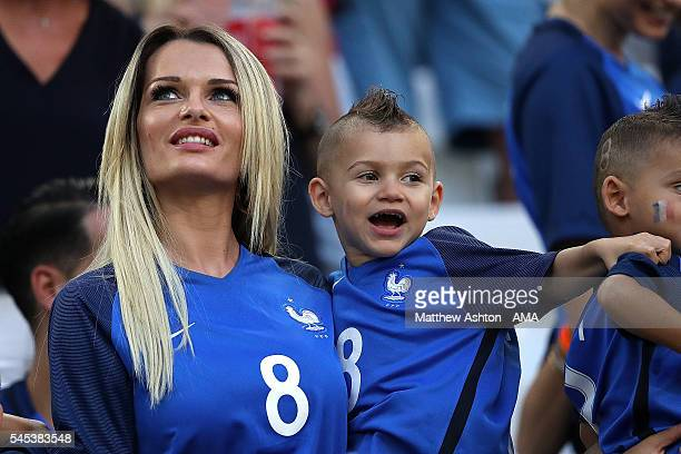 Dimitri Payet's wife Ludivine Payet looks on with their son prior to the UEFA Euro 2016 Semi Final match between Germany and France at Stade...