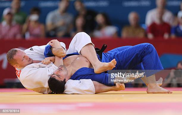 Dimitri Peters of Germany and Tagir Khaibulaev of Russia at Excel Arena London as part of the 2012 London Olympic games on 2nd August 2012