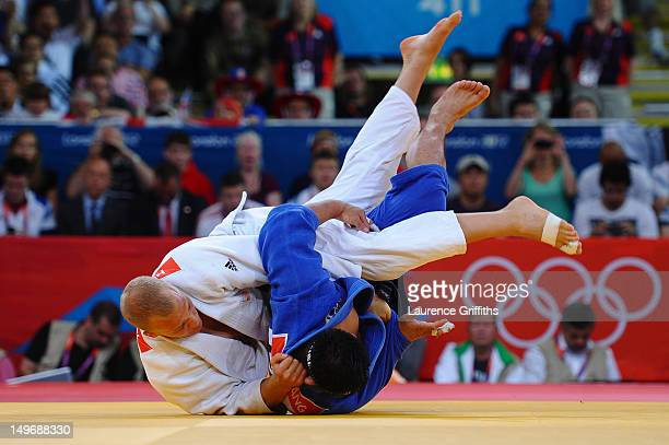Dimitri Peters of Germany competes with Ramziddin Sayidov of Uzbekistan in the Men's 100 kg Judo on Day 6 of the London 2012 Olympic Games at ExCeL...