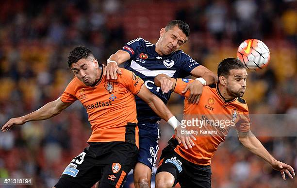 Dimitri Petratos and Jack Hingert of the Roar compete for the ball against Daniel Georgievski of the Victory during the ALeague Elimination Final...