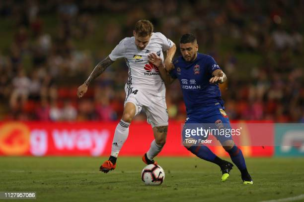 Dimitri Petratos of Newcastle Jets contests the ball with Armando Sosa Pena of Wellington Phoenix during the round 18 ALeague match between the...
