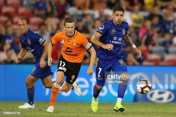 Dimitri Petratos of Newcastle Jets controls the ball from Matt McKay of the Brisbane Roar during the round 12 ALeague match between the Newcastle...