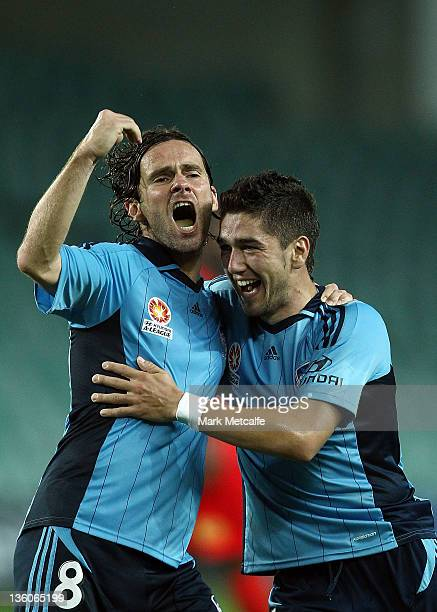 Dimitri Petratos of Sydney celebrates with teammate Karol Kisel after scoring a goal during the round 12 ALeague match between Sydney FC and Adelaide...