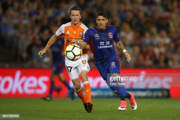 Dimitri Petratos of the Jets and Matthew McKay of the Roar to contest the ball during the round 16 ALeague match between the Newcastle Jets and the...