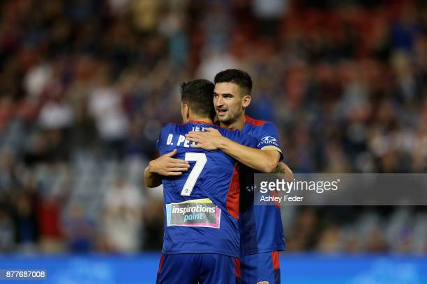 Dimitri Petratos of the Jets and Steven Ugarkovic of the Jets embrace to celebrate a goal during the round eight ALeague match between the Newcastle...