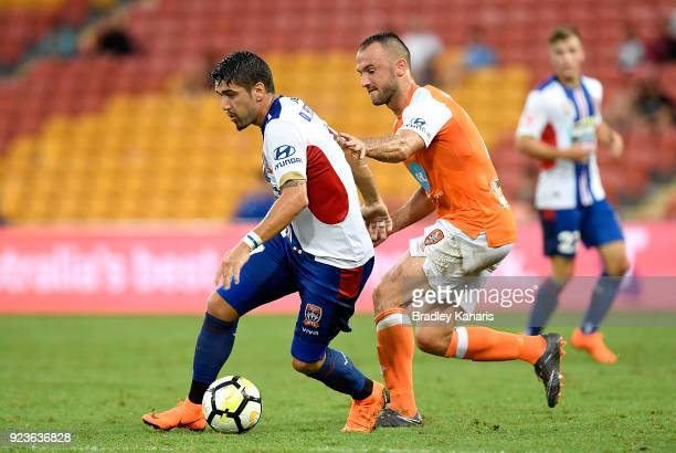 Dimitri Petratos of the Jets breaks away from the defence during the round 21 ALeague match between the Brisbane Roar and the Newcastle Jets at...