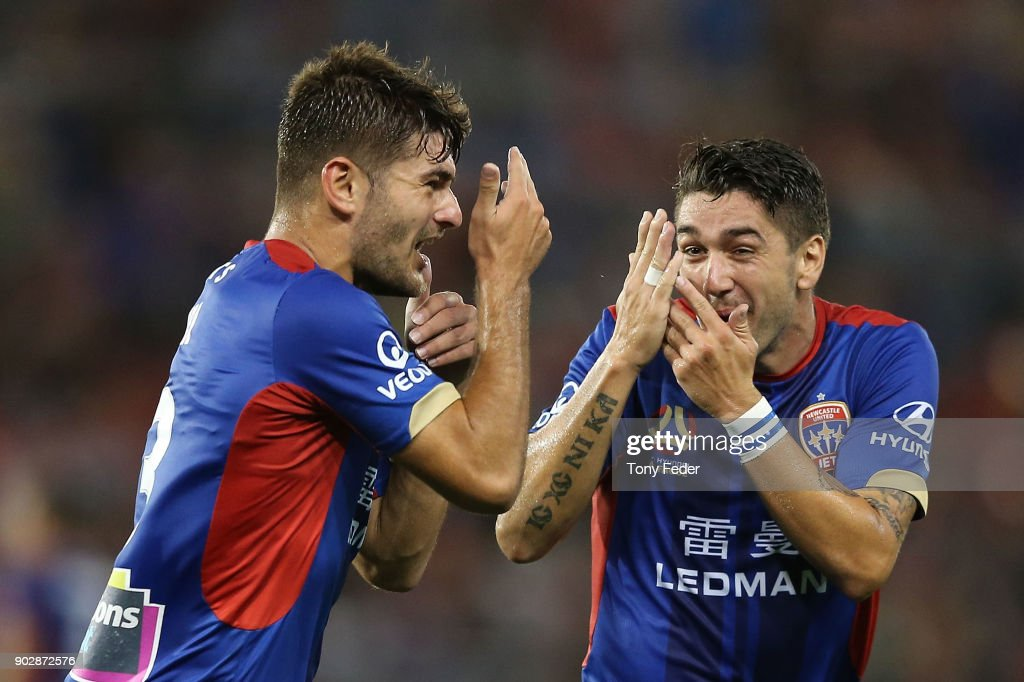 Dimitri Petratos (R) of the Jets celebrates with team mate Ivan Vujica (L) during the round 15 A-League match between the Newcastle Jets and the Central Coast Mariners at McDonald Jones Stadium on January 9, 2018 in Newcastle, Australia.