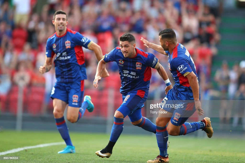 Dimitri Petratos of the Jets celebrates with team mates after scoring a goal during the round 11 A-League match between the Newcastle Jets and the Adelaide United at McDonald Jones Stadium on December 16, 2017 in Newcastle, Australia.