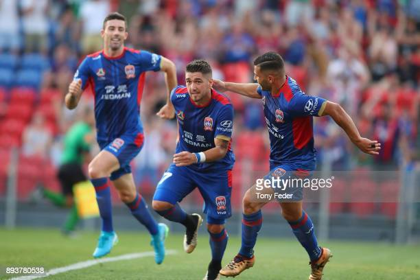 Dimitri Petratos of the Jets celebrates with team mates after scoring a goal during the round 11 ALeague match between the Newcastle Jets and the...