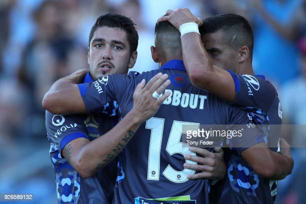 Dimitri Petratos of the Jets celebrates with team mates after scoring a penalty during the round 22 ALeague match between the Newcastle Jets and...