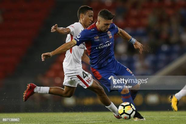 Dimitri Petratos of the Jets contests the ball against Keanu Baccus of the Wanderers during the round 12 ALeague match between the Newcastle Jets and...