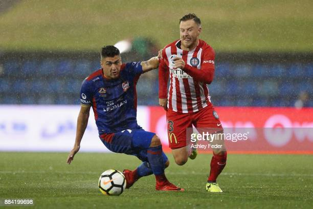 Dimitri Petratos of the Jets contests the ball against Scott Jamieson of Melbourne City during the round nine ALeague match between the Newcastle...