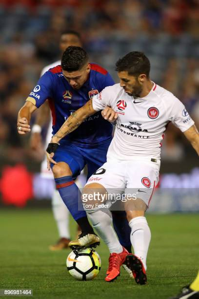 Dimitri Petratos of the Jets contests the ball with Alvaro Cejudo of the Wanderers during the round 12 ALeague match between the Newcastle Jets and...