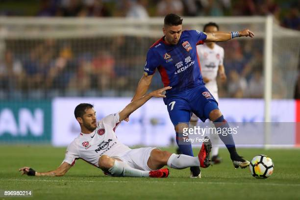Dimitri Petratos of the Jets contests the ball with Brendan Hamill of the Wanderers during the round 12 A-League match between the Newcastle Jets and...