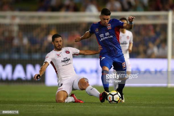Dimitri Petratos of the Jets contests the ball with Brendan Hamill of the Wanderers during the round 12 ALeague match between the Newcastle Jets and...