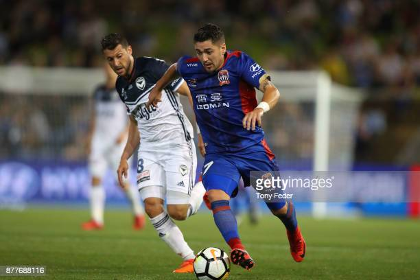 Dimitri Petratos of the jets contests the ball with Matias Sanchez of the Victory during the round eight ALeague match between the Newcastle Jets and...