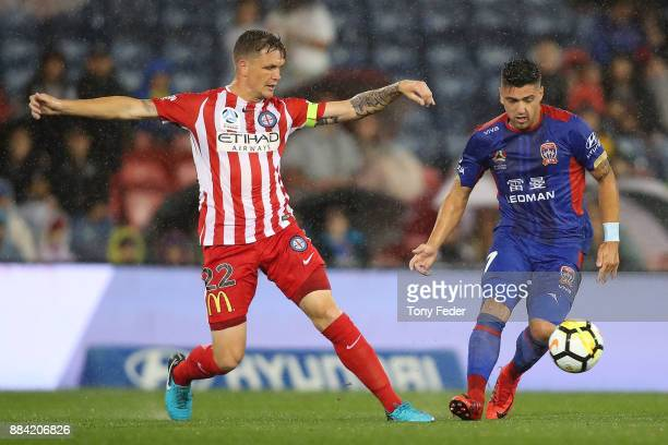 Dimitri Petratos of the Jets contests the ball with Michael Jakobsen of the Melbourne City during the round nine ALeague match between the Newcastle...