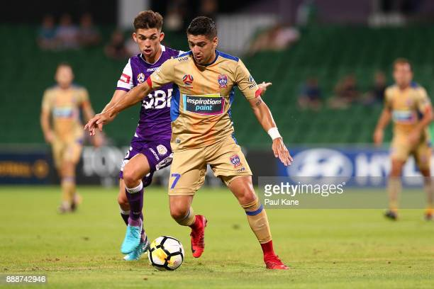 Dimitri Petratos of the Jets controls the ball against Brandon Wilson of the Glory during the round 10 ALeague match between the Perth Glory and the...